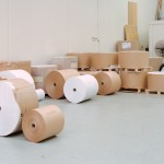 Raw paper stock reels ready for printing